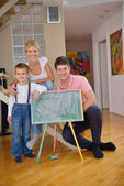 Family drawing on school board at home — Stockfoto