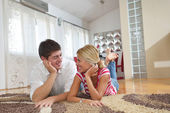 Young couple at home in bright living room — Foto de Stock