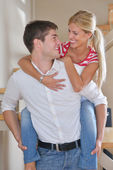 Young couple at home in bright living room — Foto Stock