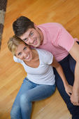 Young couple at home in bright living room — Stock Photo