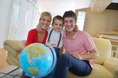 Family have fun with globe — Stockfoto