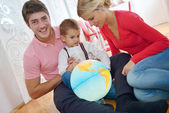 Family have fun with globe — Foto Stock