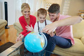 Family have fun with globe — Foto de Stock