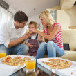 Family eating pizza — Stock Photo #38959799