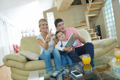 Family at home using tablet computer — Foto de Stock