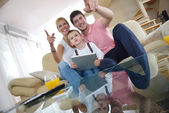 Family at home using tablet computer — Stock Photo