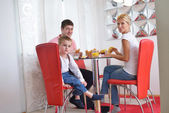 Family have healthy breakfast at home — Stock Photo