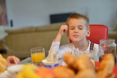 Boy have healthy breakfast at home — Stock Photo