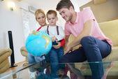 Family have fun with globe — Zdjęcie stockowe