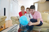 Family have fun with globe — Foto de Stock