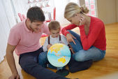Family have fun with globe — Stock Photo