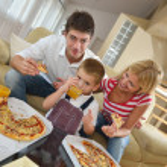Family eating pizza — Stock Photo #39075467