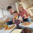Family eating pizza — Stock Photo