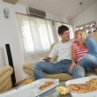 Couple at home eating pizza — Stock Photo #39076191