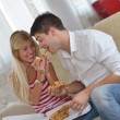 Couple at home eating pizza — Stock Photo #39076587