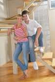 Relaxed young couple sitting on steps at home — Stock Photo