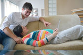 Pregnant couple at home using tablet computer — Stock Photo