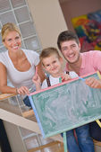 Family drawing on school board at home — Stock Photo