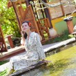 Woman at fountain,tropical resort — Stock Photo