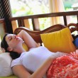 Woman resting at couch, tropical resort — Stock Photo