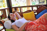 Woman resting at couch, tropical resort — Foto Stock