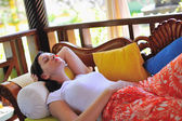 Woman resting at couch, tropical resort — Foto de Stock