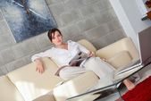 Woman reading magazine — Stock Photo