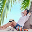 Woman under the palm tree — Stock Photo