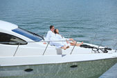Young couple on yacht — Stock Photo
