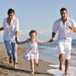 Happy young family have fun on beach — Стоковое фото #4389039