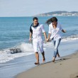 Happy young couple have fun at beautiful beach — Stock Photo #4389154