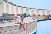 Couple at wooden jetty — Stock Photo