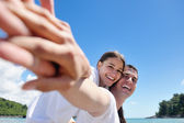 Couple have fun at the beach — Stock Photo