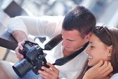 Couple looking photos on camera — Stock Photo