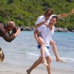 Photographer taking photo on beach — Stock Photo #44970283