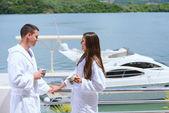 Couple next to yacht — Stock Photo