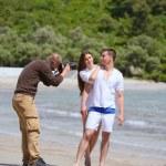 Photographer taking photo on beach — Stock Photo