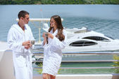 Young couple at yacht — Stock Photo