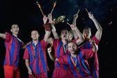Jogadores de futebol, comemorando a vitória — Fotografia Stock