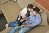 Couple at home using tablet computer — Stock Photo