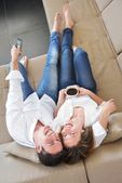 Couple relax at home — ストック写真