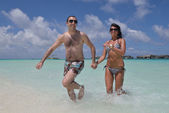 Couple have fun on beach — Stockfoto