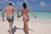 Couple have fun on beach — Stock Photo