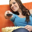 Постер, плакат: Woman eat popcorn watching movies