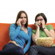 Friends eating popcorn and watching tv — Stock Photo