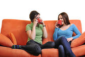 Two young women with cup of coffee talking — Stock Photo