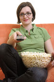 Woman with popcorn watching tv — Stock Photo