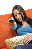 Woman eat popcorn and watching tv — Stock Photo