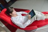 Woman using tablet pc at home — Stock Photo