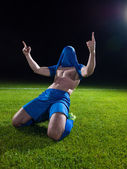 Soccer player with jersey on his head — ストック写真